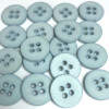 Small pale blue button with four holes, sold in bags of 50 buttons.