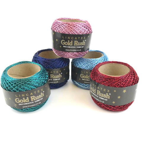 Five Lincatex balls of chainette yarn in five different colours.
