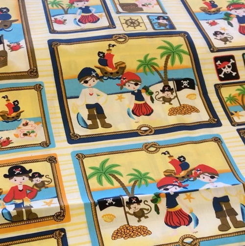 Vibrant coloured cotton fabric with pirate printed design