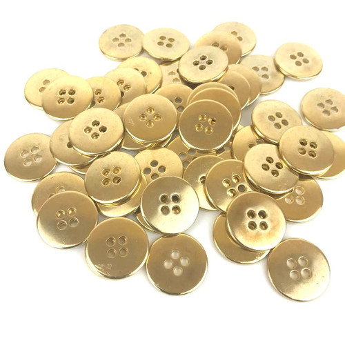 Heavy weight gold metal button with four holes.