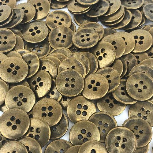 Solid brass heavy weight button with four holes in antiqued brass colour.