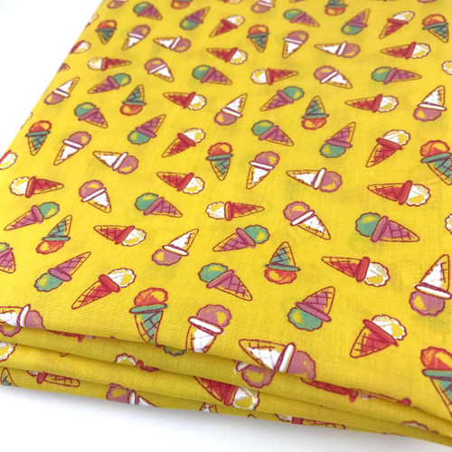Colourful ice cream cones printed on lemon yellow background.