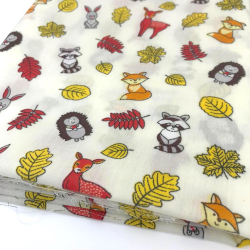 Forest animals on cream background printed poly cotton fabric.