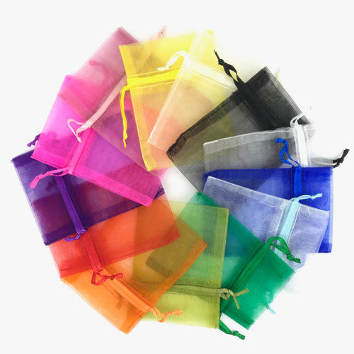 Assorted colours of organza drawstring pouch bag in spiral formation.