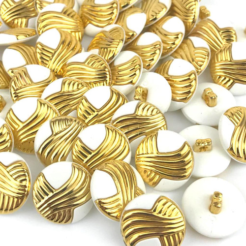 White and gold shank button. Very attractive, stylish button.