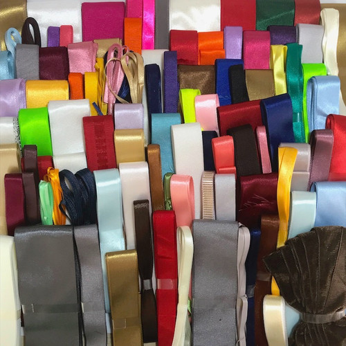 Assorted selection of narrow and wide ribbons in variety of colours, styles and wides.
