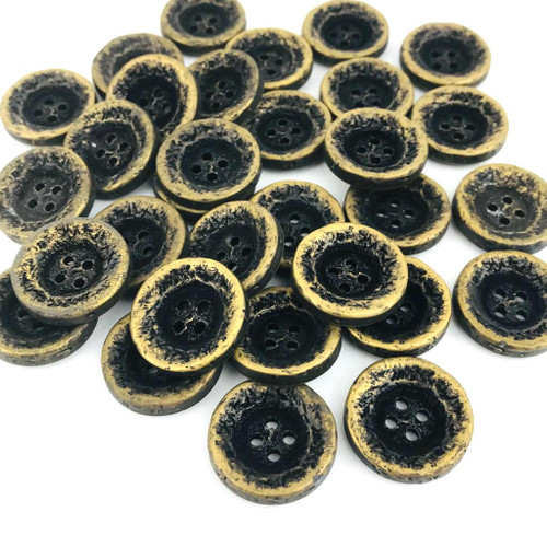 Rustic gold metal button with black creating a vintage worn appearance.