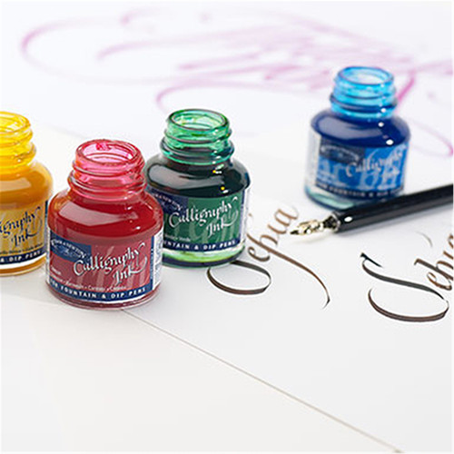 Calligraphy in bottles on a sheet of calligraphy paper.