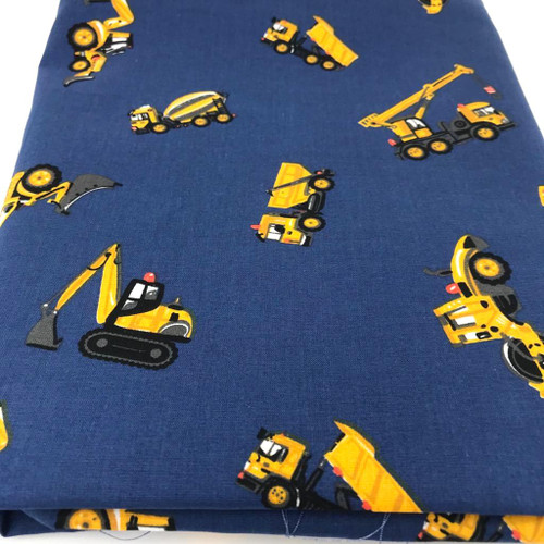 Yellow digger truck excavation vehicles on navy cotton fabric.