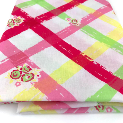 Diagonal lines of printed colour on a white polycotton. Very summery and colourful.