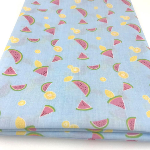 Sky blue polycotton with printed watermelons and lemons.