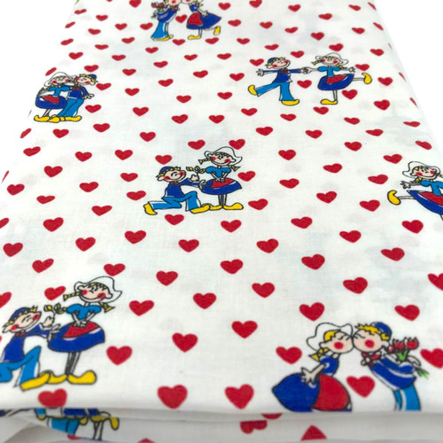 White cotton fabric with dutch couple in clogs and red hearts.