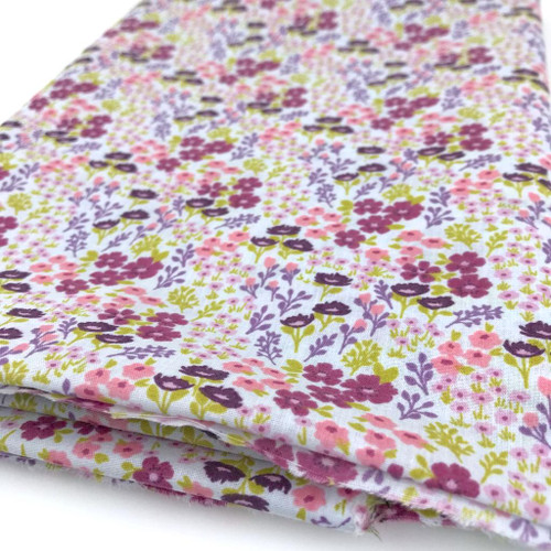Delightful small flowers in  many summery colours printed on sky polycotton fabric.