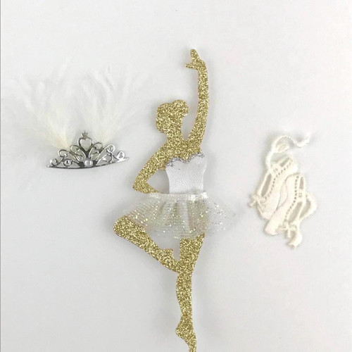 Gold glitter ballerina with white tutu, feather mask and ballet shoes.