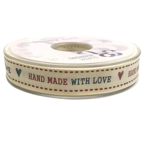 Hand Made with Love in capital text in red and navy blue with a heart either end and red dashed line either edge of the ribbon. Cream woven ribbon.