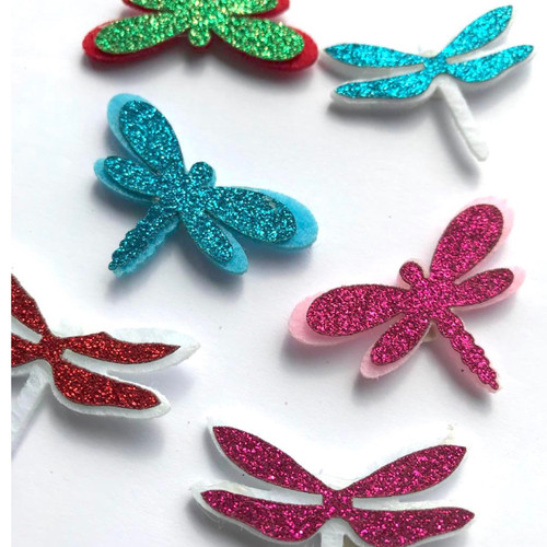 Sparkly glitter on hard felt dragonfly embellishments with self adhesive backing.