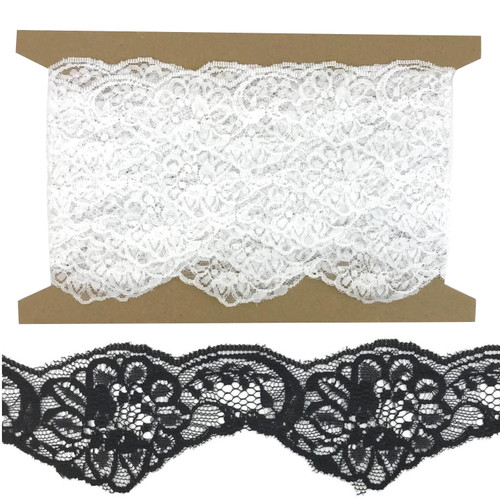 Double scolloped edge flat lace in black or white on a 10 meter card.