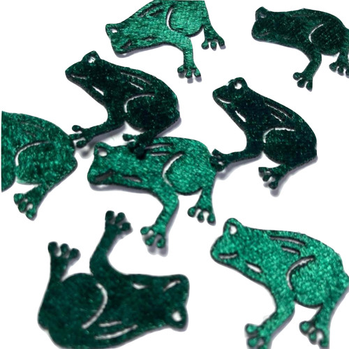 Green frog embellishments cut from fabric with a laser