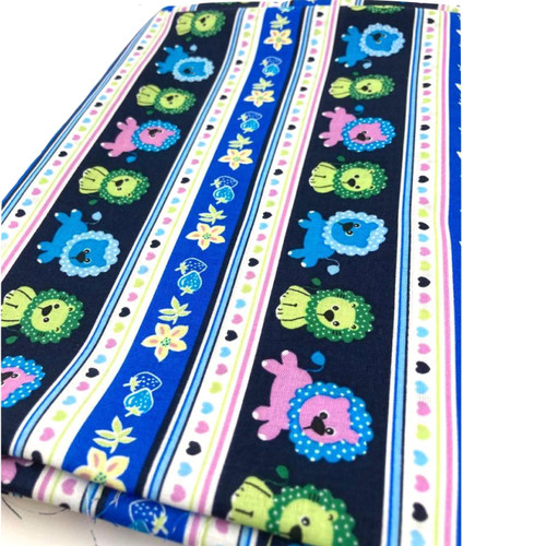 Fun lions on blue 100% cotton fabric print.