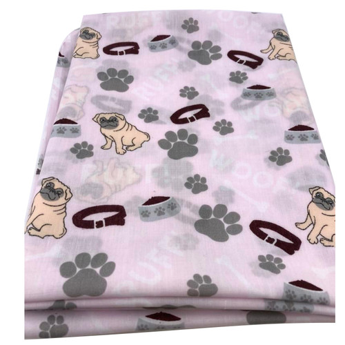 Pink polycotton fabric with pug dog print.