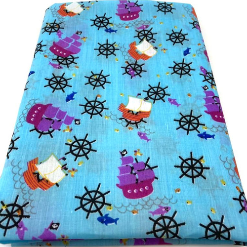 Turquoise polycotton fabric with sailing ships in purple and red.