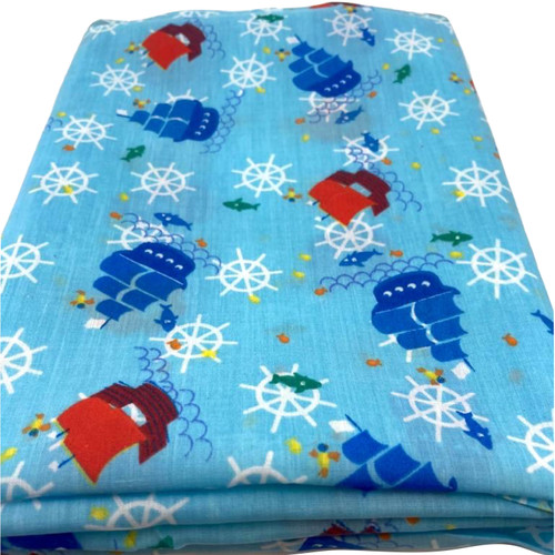 Turquoise blue polycotton fabric with sailing ships in blue and red printed at sea.