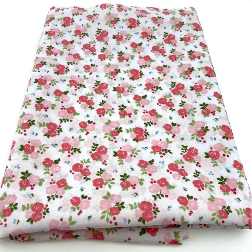 Small pink triple rose printed on white polycotton fabric.
