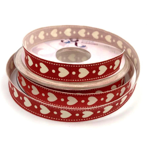 Red canvas ribbon with cream hearts in a vintage style design. 20 meter roll measuring 16mm wide.