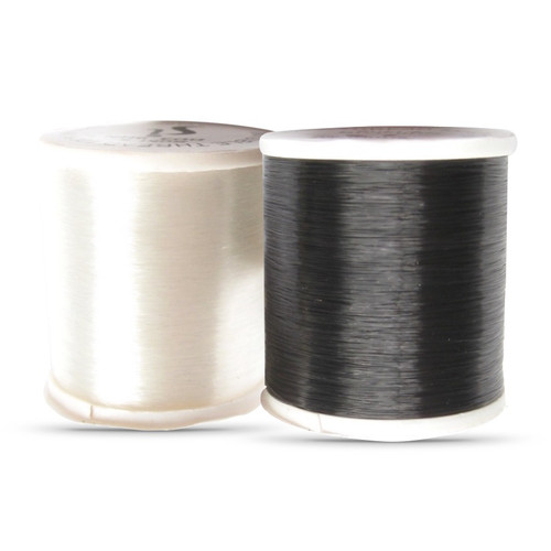 White or Black filament thread, so fine the stitches appear invisible.