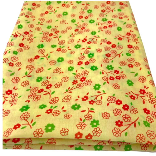 Yellow polycotton fabric with small red and green flowers.
