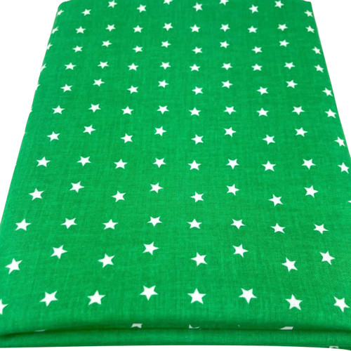 Green emerald cotton fabric with white printed stars.