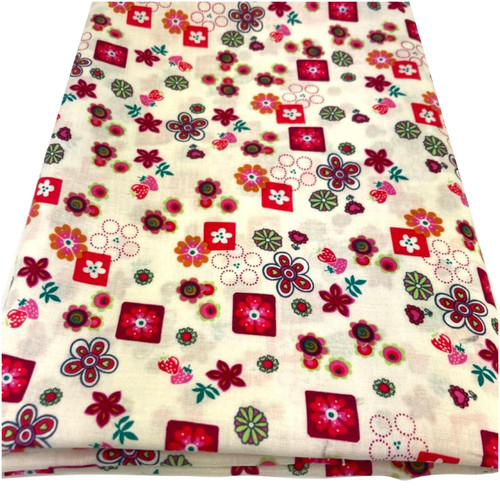 Small red flowers on cream cotton fabric.