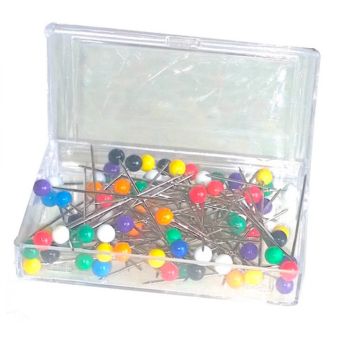 Transparent box holding approximately 80 multi coloured headed pins.