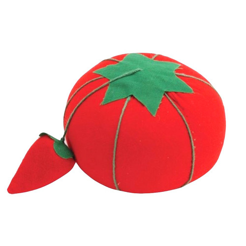 Tomato pin cushion with strawberry emery to sharpen your pins and needles each time you use it.