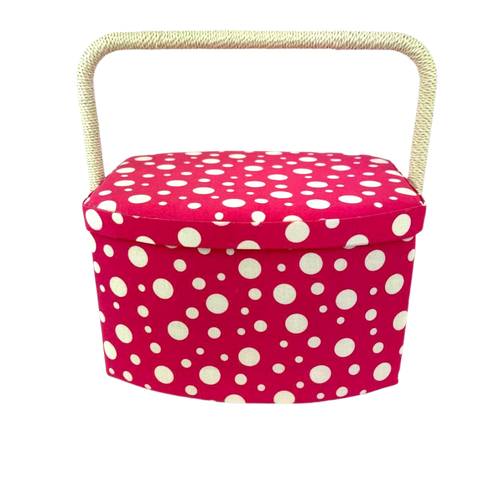 Pink and white dot sewing box with adjustable handle and ample storage.