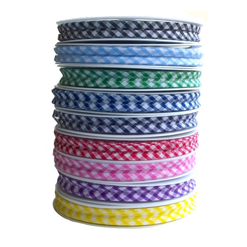 20mm bias binding tape with pre folded edges in gingham cotton fabric. Nine pretty colours sold by the meter or a roll of 25 meters