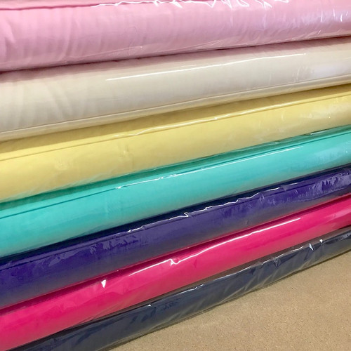 pure cotton fabric in several pretty colours, each one and half meters wide, sold by the meter.