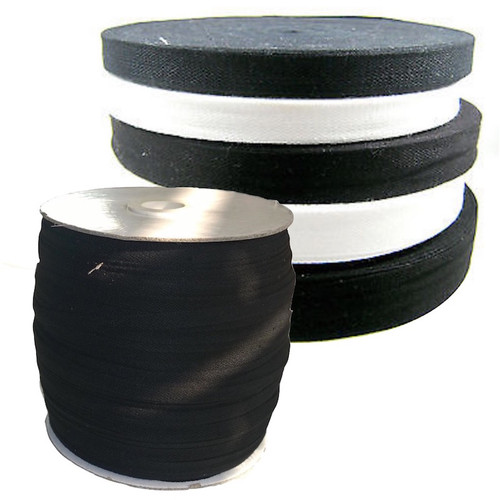 Cotton tape in black or white as full rolls.
