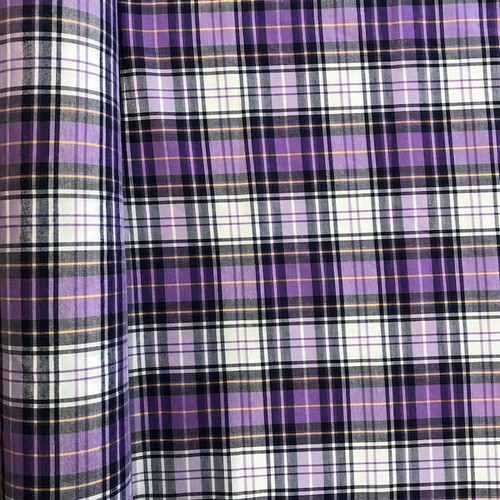 Check fabric similar to tartan in cotton and polyester mix. Sold by the meter.
