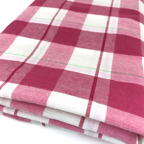 Pink check fabric similar to tartan in cotton and polyester mix.