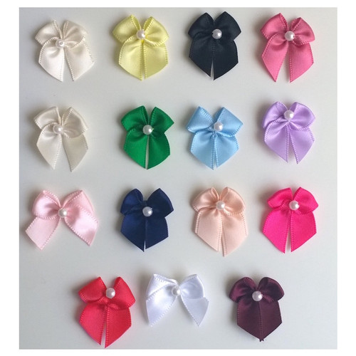 15 shades of bows with pearl bead centre.