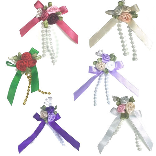 Satin ribbon roses in a triple cluster each in mixed colours with green leaves and pearl beads.