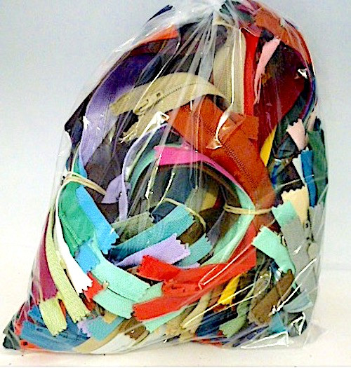 Bag of 50 assorted zips in various colours and sizes.