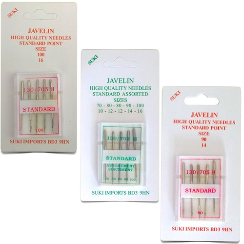 Three packets of sewing machine needles in various sizes.