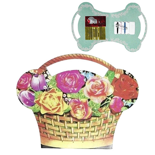 Retro printed sewing kit which folds open with sewing needles, buttons, threader and more inside.