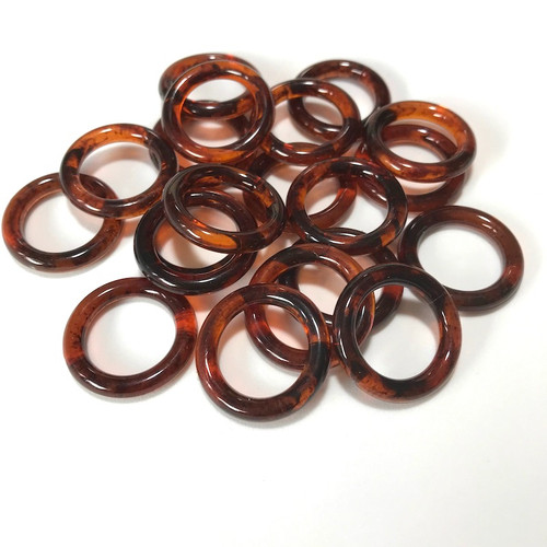 Acrylic amber rings in packets of 20 pieces.