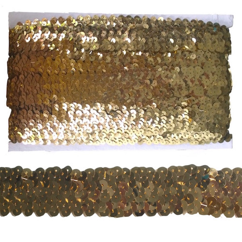 Gold sequin trim, elasticated to make garment sewing and movement easy. On a 10 meter card