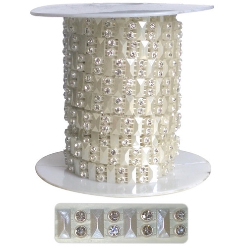 Silver gems set in ivory studded plastic casing. Beaded trim on a 10 yard roll.