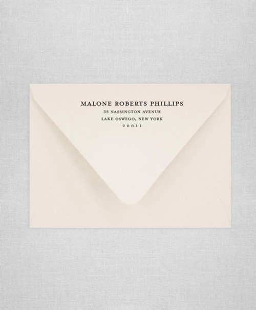 Cream puff wedding envelopes with return addressing and wax seals