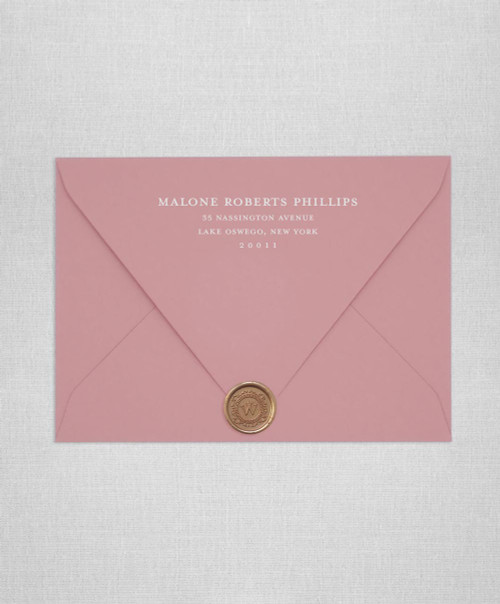 Dusty Pink wedding invitation envelopes with white ink addressing and a wax seal
